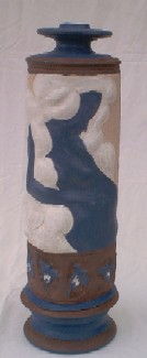 Tall Relief Portrait Slab and Thrown Vase